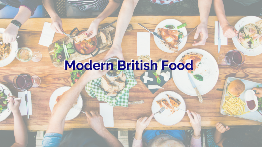 a birdseye view of a long wooden table with lots of delicious modern British food