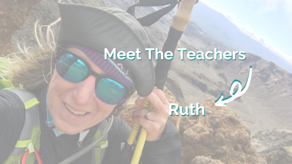 A close up of Intrepid English Teacher Ruth in a safety harness, hat and sunglasses over a beautiful backdrop