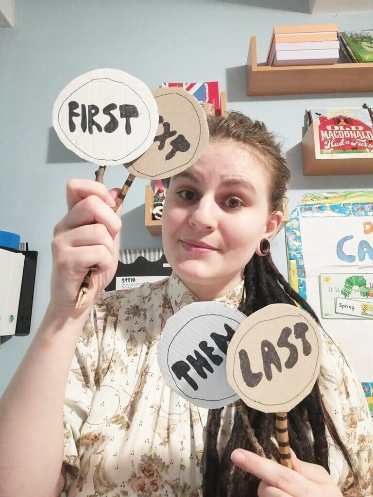 Alice holding some sequential phrases: first, next, then, last.